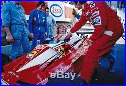 Niki Lauda autograph, In-Person signed 8X12 F1 Ferrari photo with James Hunt